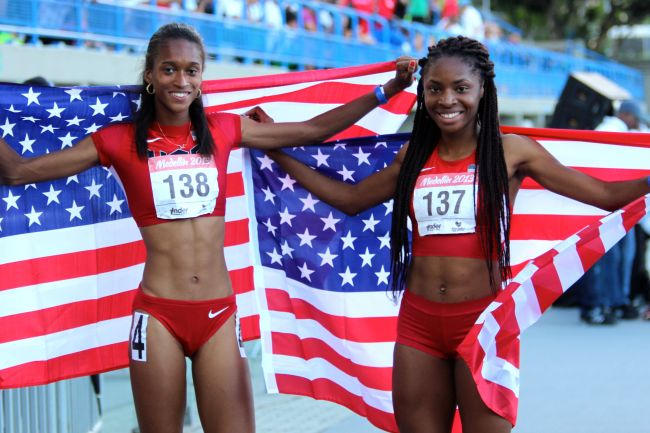 Kendall Baisden (Left) and Courtney Okolo (Right) celebrate Team USA's  4x400m women's victory at the 2013 Pan American Juniors.  (Photo Credit: www.nationalscholastic.org)
