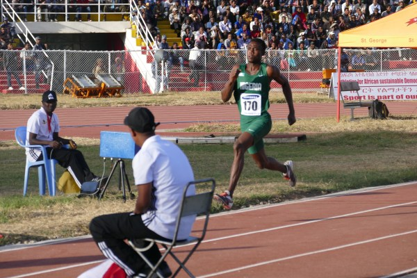 Theddus Okpara enroute winning a Silver Medal in the Long Jump event.