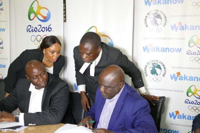 Wakanow's Chief Marketing Officerr Victoria Onwubiko and NOC's Legal Adviser, Barrister Vincent Nwana look on as Obinna Ekezie and Tunde Popoola sign an agreement during the unveiling in Lagos.
