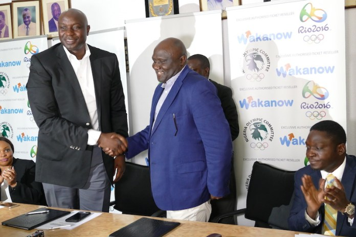 Managing Director of Wakanow Limited Mr. Obinna Ekezie and Secretary General of the NOC, Mr.Tunde Popoola during the unveiling at the NOC Boardroom on Tuesday, April 12, 2016.