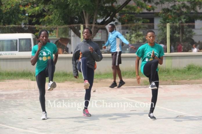 Team MoC female athletes warming up.