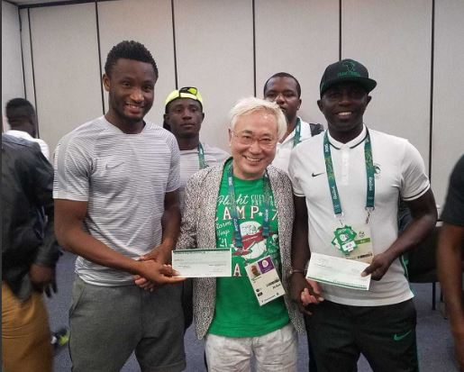 Japanese Surgeon, Takasu presenting the team with cheques after the game against Honduras