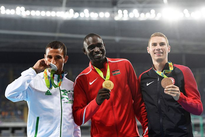 (L-R) Silver medalist Taoufik Makhloufi of Algeria, gold medalist David Lekuta Rudisha of Kenya and bronze medalist USA's Clayton Murphy pose during the medal ceremony for the Men's 800m Final. (Photo Credit: Quinn Rooney/Getty Images)