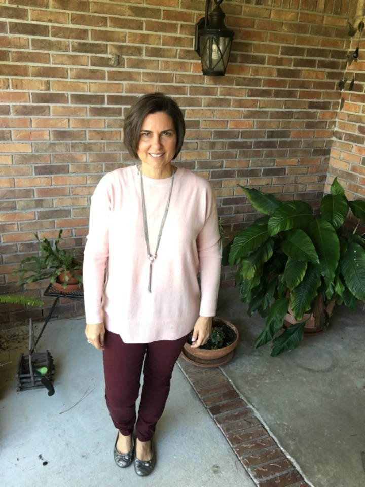 Pink sweater and wine skinnies.