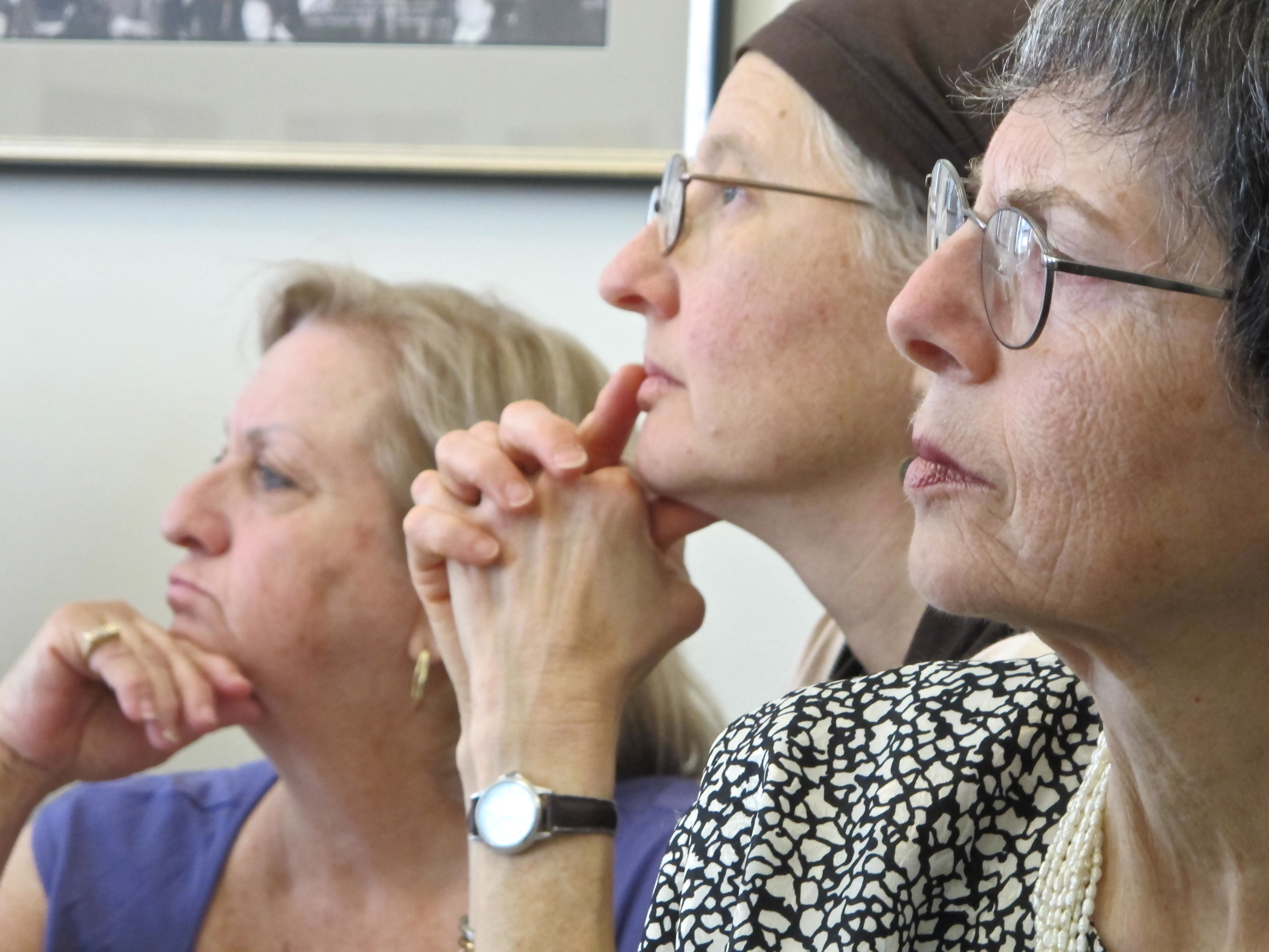 Three women lost in thought
