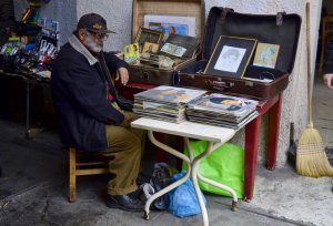 Old man selling records in the bazaar