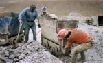 Potosi miners carrying silver ore inside Cerro Rico