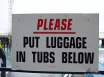 Put Luggage in Tubs Below sign