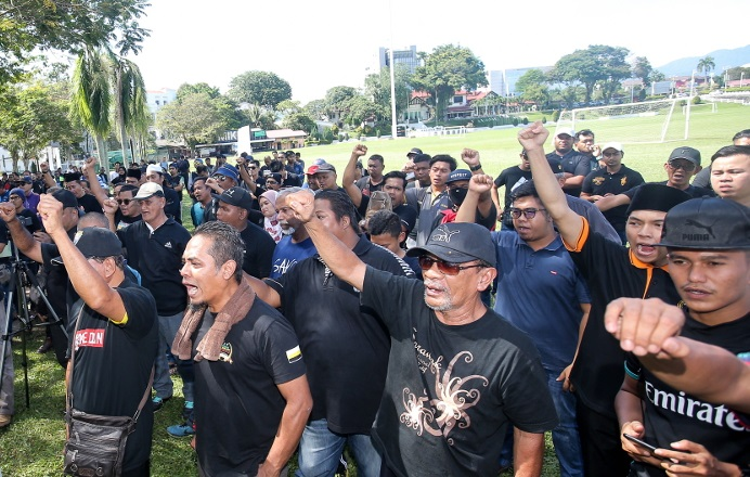 A group of people mostly dressed in black gathered at the Ipoh Padang Ipoh to demand justice for Adib and repeatedly shouted for Tun Dr Mahathir Mohamad to resign as the prime minister