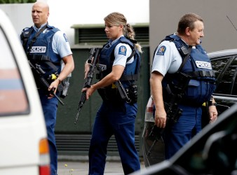 Police officers outside one of the mosques that was attacked in central Christchurch New Zealand on Friday.Credit Associated Press AP