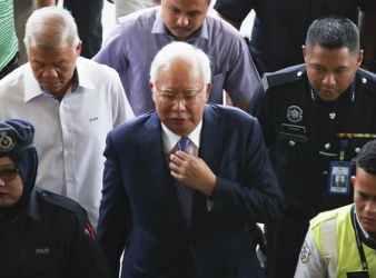 Former Prime Minister Najib Razak arriving in court in Kuala Lumpur on Wednesday. EPA
