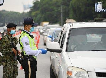 police diraja malaysia compound mco