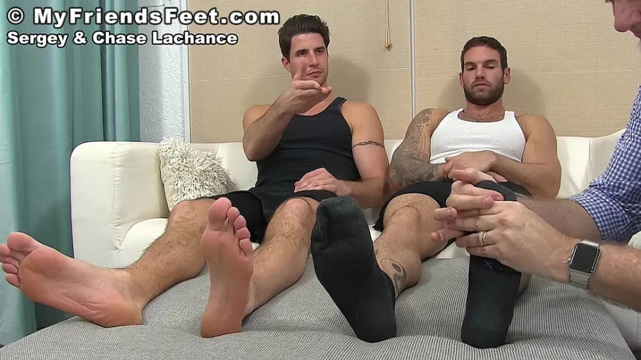 Sergey puts his bare soles up while Chase Lachance's black socked feet get massaged - My Friends' Feet