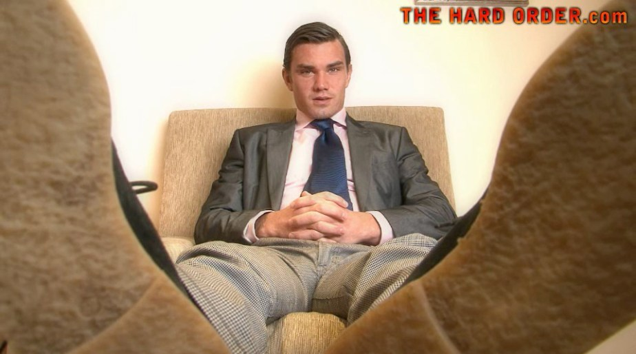 Master Harvey in his suit showing off his dress shoes