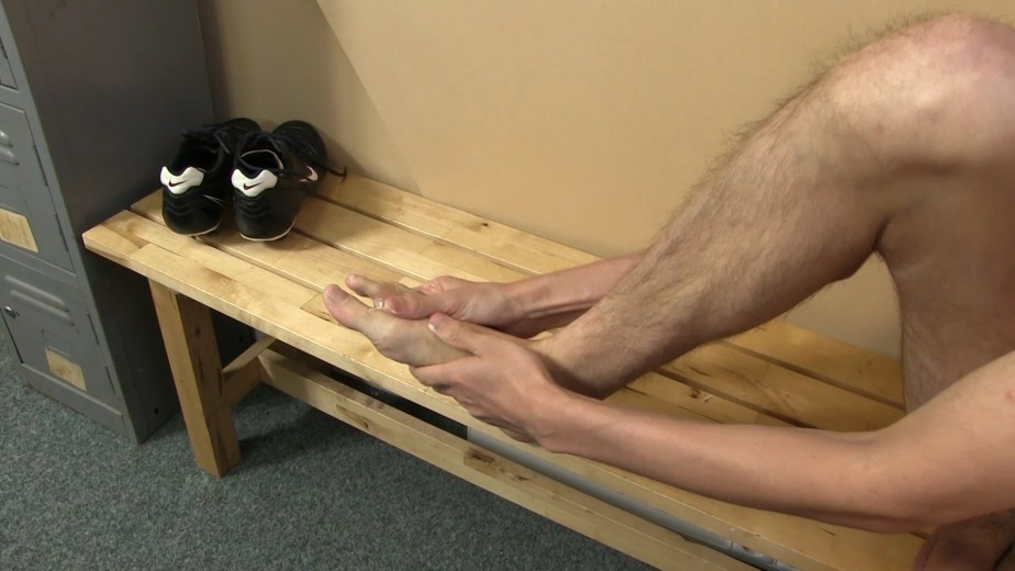 Jasper James rubs moisturiser into his jock feet in the locker room for TwinkyFeet