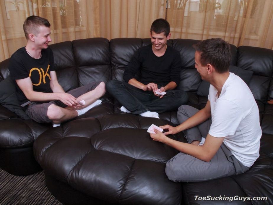 Three friends, Jacob, Gabe, and Tobi, hang out in their white socks for Toe Sucking Guys