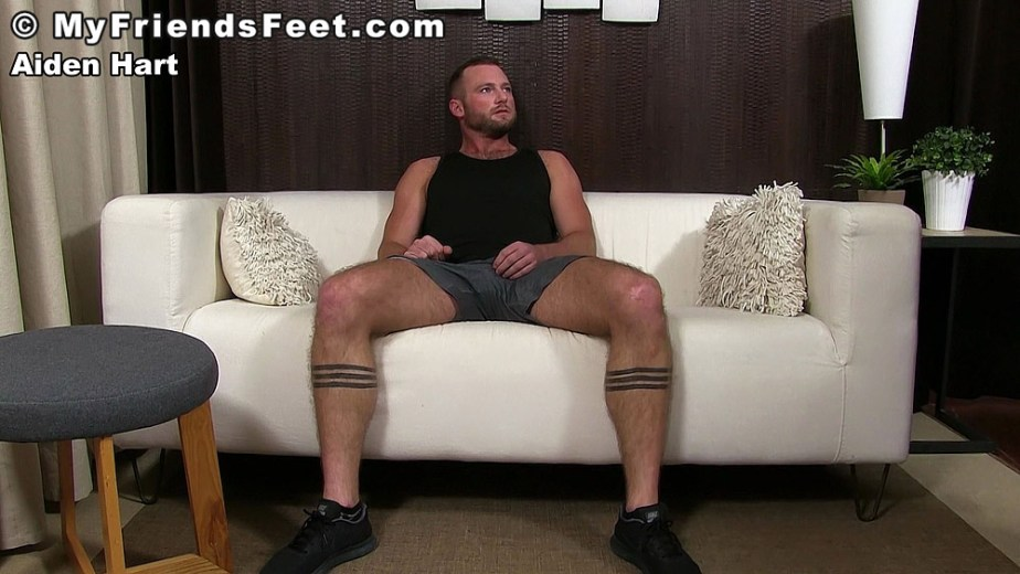 Aiden Hart sits back on the couch with his sneakers on for My Friends Feet