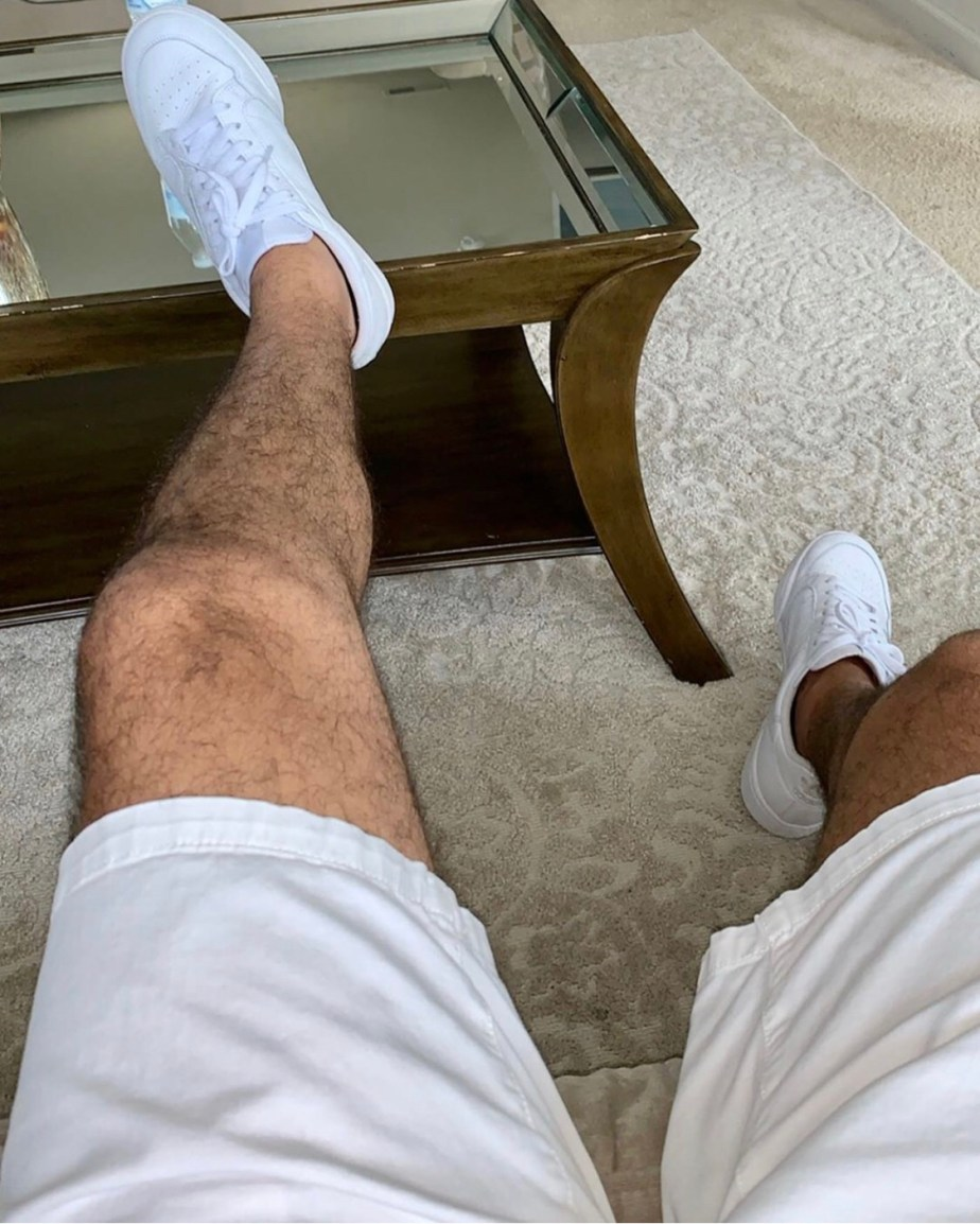 Sockless in white Adidas sneakers