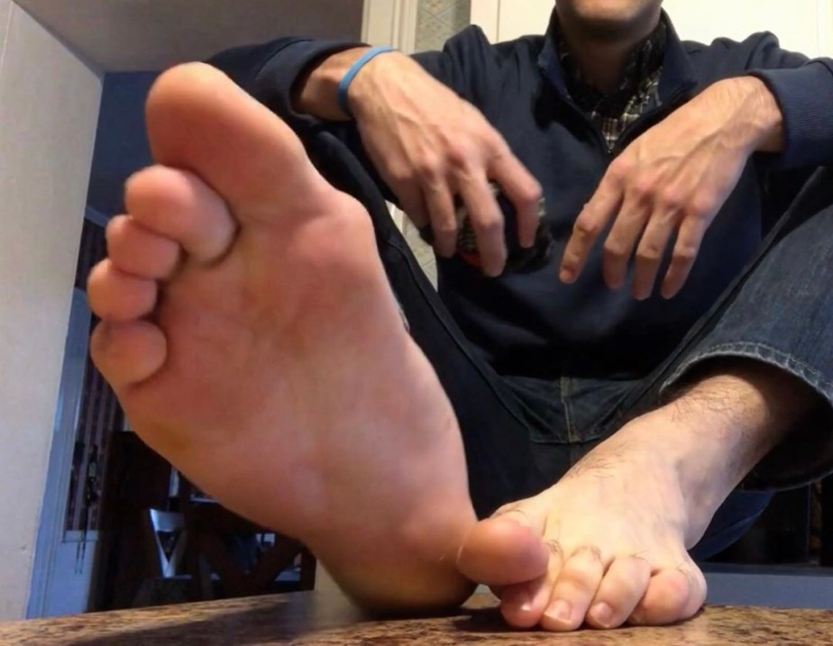 Brosoxnsoles_ size 12 socked and bare feet on the counter