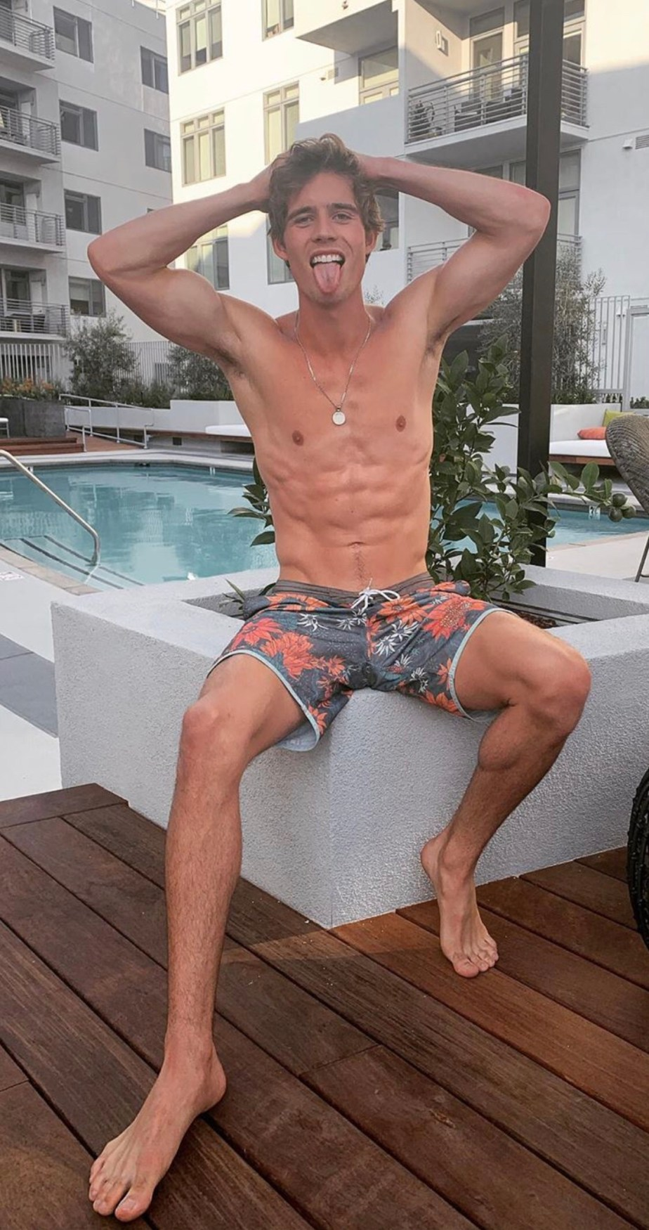 Leif.offerdahl shirtless and barefoot by the pool