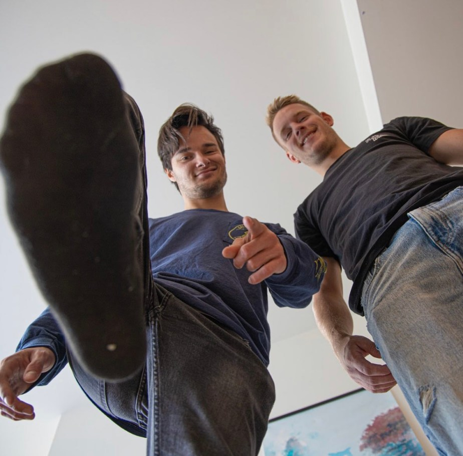 Lenny shows off his black socked foot with Johnny for giant_and_tiny