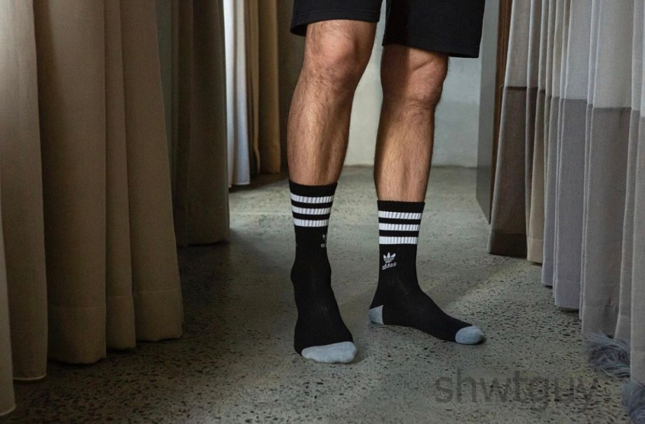 Shwtguy_official size 13 feet socked in black Adidas crew socks