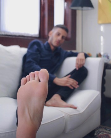 eroszilla1 shows off his bare sole on the sofa