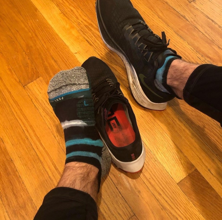 Jakesamazingfeet shows off his bare and socked feet out of worn Nike sneakers