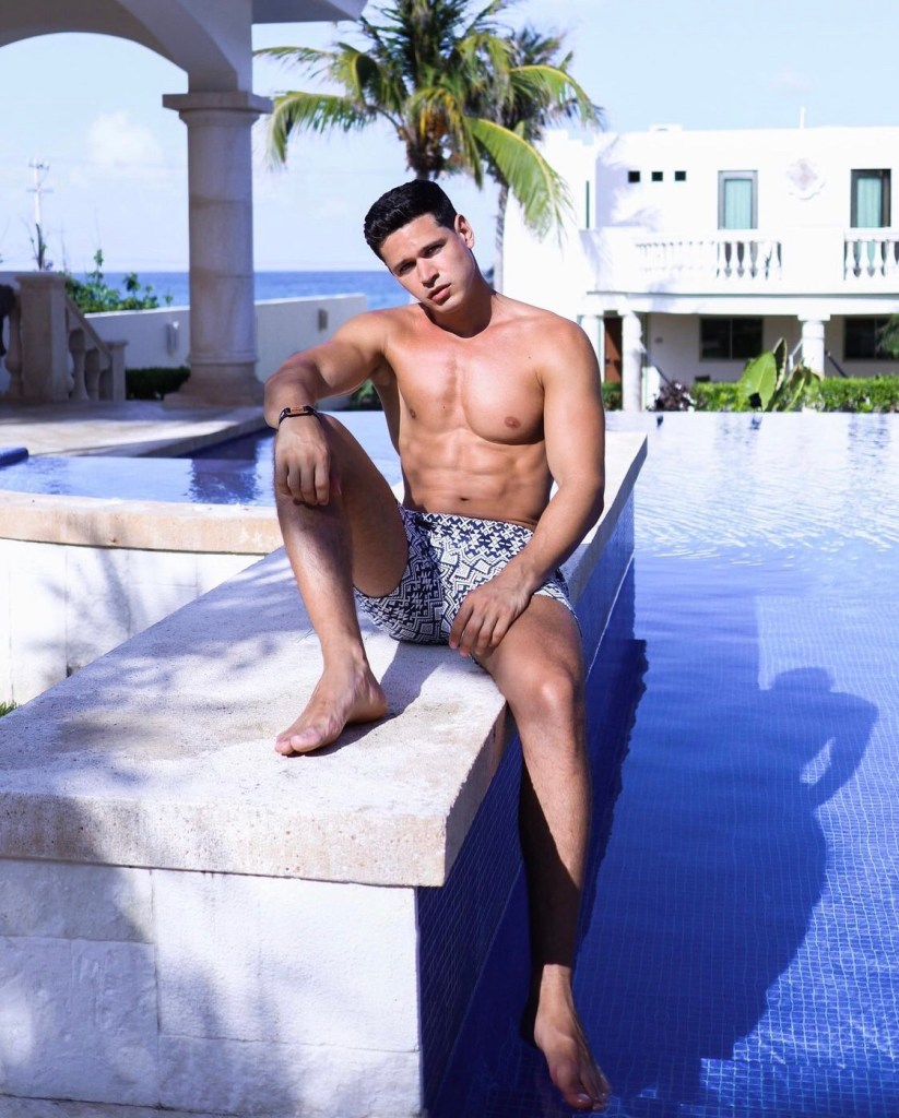 andreabzzz shirtless and barefoot by the pool