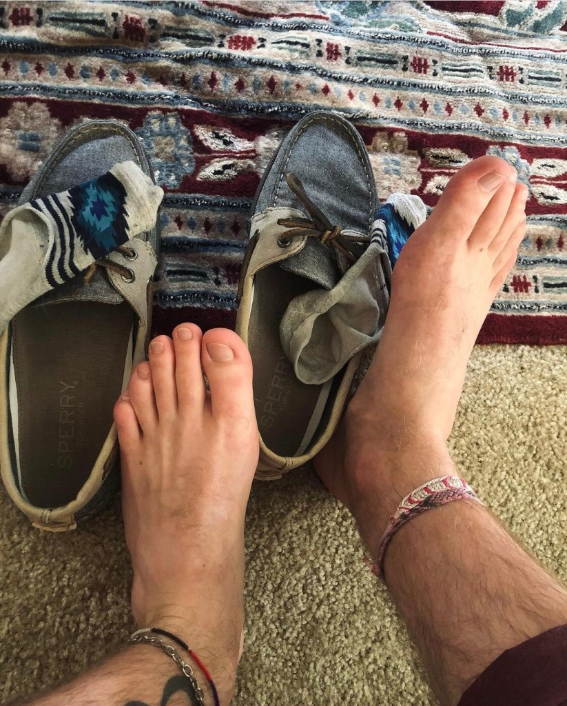 pnw_feet_ barefoot out of socks and Sperry boat shoes