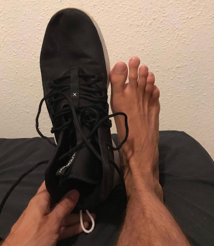 bigfeetforsale_4.0's size 12 feet compared to Justin's size 17 sneakers