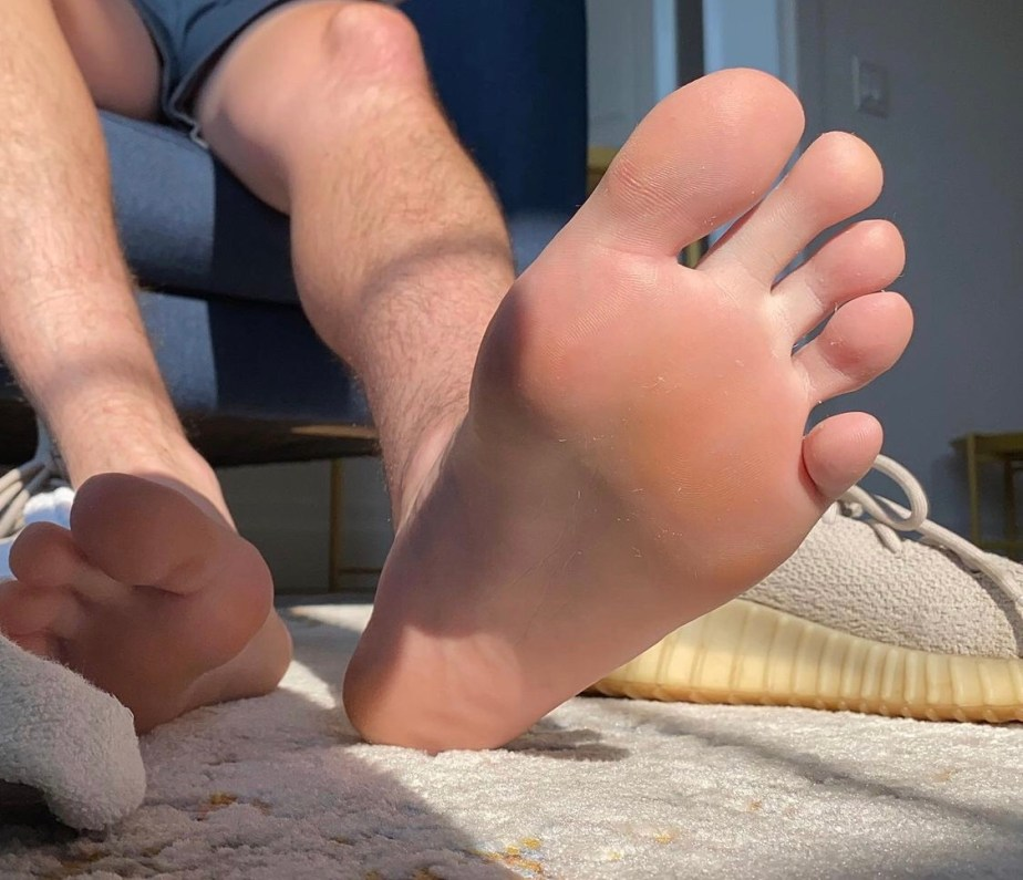 justinpageft's bare soles out of white socks and sneakers