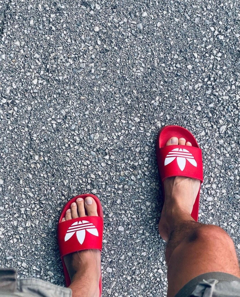 t.yp3 barefoot in and out of red Adidas slides