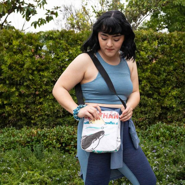woman with white recycled crossbody bag