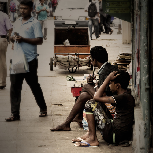 Two Guys waiting for the Bus in Colombo