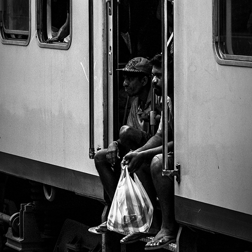 Two guys waiting for the train to leave the station