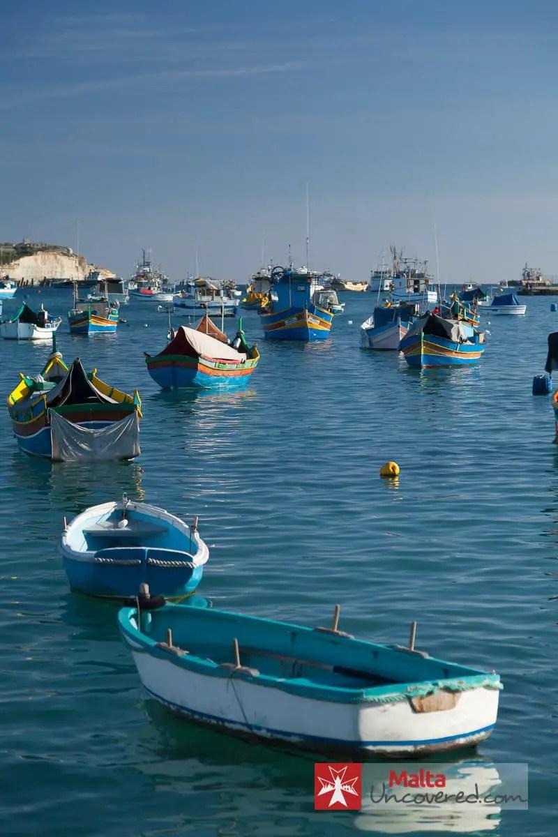 Marsaxlokk harbour is full of fishing boats.