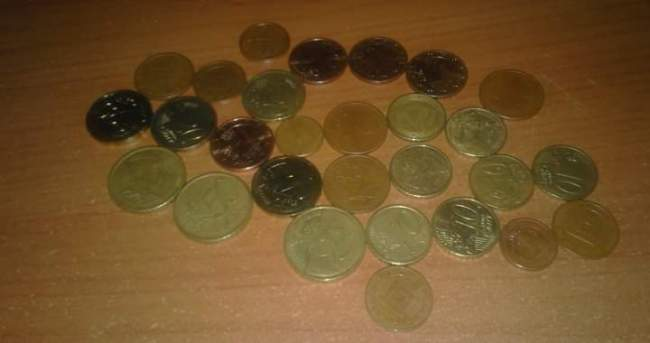 a few coins laying on a desk
