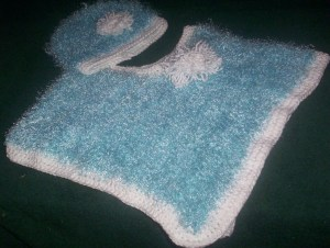 Blue poncho and bonnet