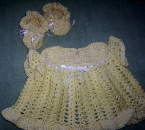 Little yellow dress and booties for baby girl