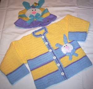 Blue and yellow sweater with bunny hat