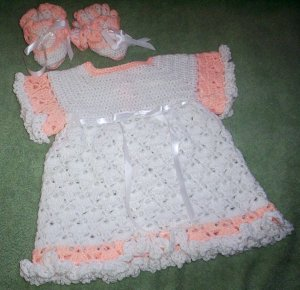 Little dress and matching booties for baby girl