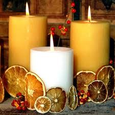 candles surrounded with dry citrus centrepiece