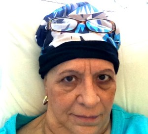 Look how brave I am! Not because I am going through chemo, but because I actually took my own picture and posted it! Complete with dark circles under eyes, all the wrinkles and a pretty snazzy head cover!