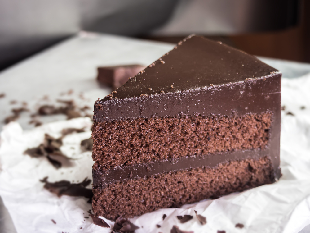 fudge cake with chocolate icing on a place