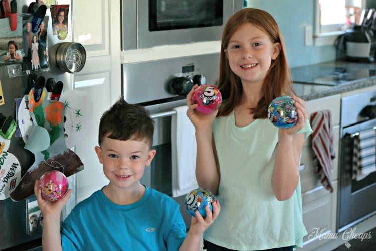 Kids Holding 5 Surprise
