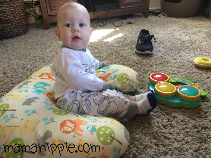 Learning to sit with his boppy.