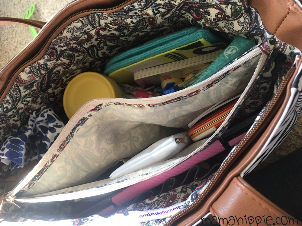 Looking for a bag that fits everything - even your baby stuff - while still looking stylish and *not* like a baby bag? The Gina from Got Oil Supplies is the perfect bag to hold all of your things - and bonus! You can fit all your essential oils in it as well. Perfect for young living and doterra mamas.