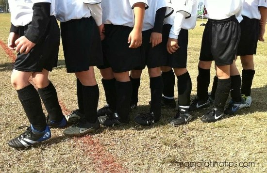 kids wearing soccer shoes and uniform