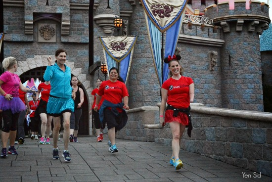 Silvia running under Sleeping Beauty Castle